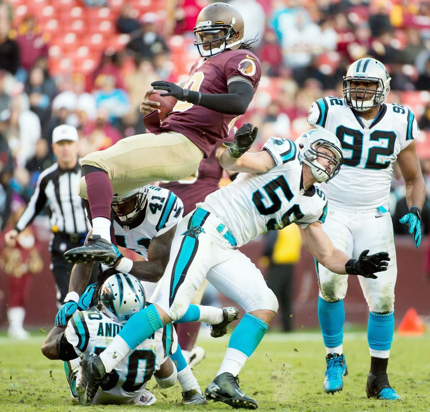 Washington Redskins quarterback Robert Griffin III (10) goes airborne while running for an eight yard gain in the fourth quarter as the Washington Redskins take on the Carolina Panthers at FedEx Field, Landover, Md., Sunday, November 4, 2012. (Andrew Harnik/The Washington Times)