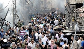 """Syrians gather at the scene of a blast in Damascus on Monday, according to state-run Al-Ikhbariya television. Several people were killed and injured, the station reported. The U.S. believes a new opposition council would prevent al Qaeda terrorists and other """"bad actors"""" from hijacking the 19-month revolt. (SANA via Associated Press)"""