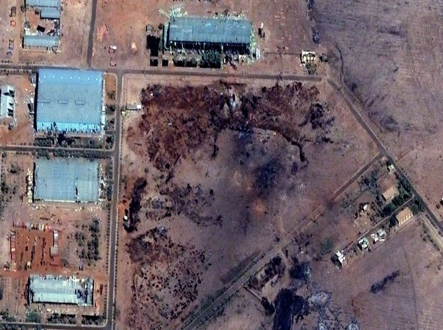 A satellite image from Oct. 25 shows the aftermath of an explosion at a Sudanese weapons factory. (Associated Press)