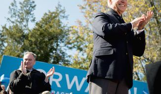 Vice President Joseph R. Biden (right) leads the charge for Virginia Democratic Senate candidate Tim Kaine at a Monday rally in Claude Moore Park in Sterling, Va. (Andrew Harnik/The Washington Times)