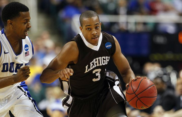 Duke's Tyler Thornton guards Lehigh's C.J. McCollum (3) during the second half of a South Regional NCAA tournament second-round college basketball game in Greensboro, N.C., Friday, March 16, 2012. Lehigh won 75-70. (AP Photo/Gerry Broome)