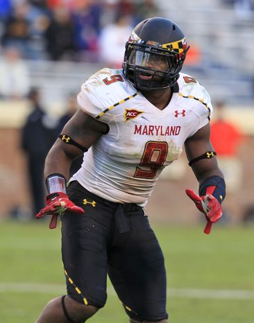 Maryland linebacker Demetrius Hartsfield (9) watches a play develop during the second half of an NCAA college football game at Scott Stadium in Charlottesville, Va., Saturday, Oct. 13, 2012. Maryland won the game 27-20. (AP Photo/Steve Helber)