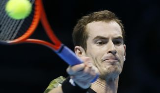 Andy Murray of Britain plays a return to Tomas Berdych of the Czech Republic during their singles tennis match at the ATP World Tour Finals in London Monday, Nov. 5, 2012. (AP Photo/Kirsty Wigglesworth)