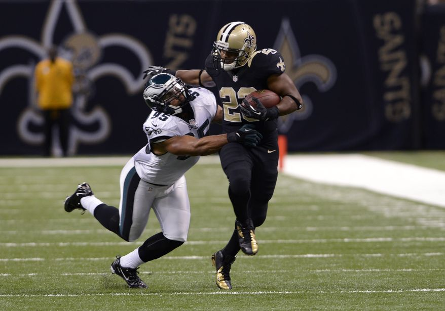 New Orleans Saints running back Pierre Thomas (23) rushes as Philadelphia Eagles outside linebacker Mychal Kendricks (95) tries to tackle during the second half an NFL football game at the Mercedes-Benz Superdome in New Orleans, Monday, Nov. 5, 2012. (AP Photo/Bill Feig)