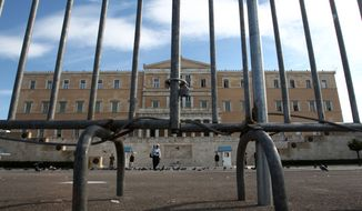 Police fences protect the Greek parliament in central Athens on Nov. 5, 2012, ahead of a 48-hour nationwide general strike. Greece is facing three days of escalating anti-austerity strikes, with state hospital doctors, taxi drivers, transport workers and journalists walking off the job. (Associated Press)