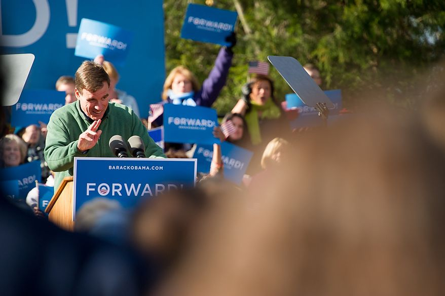 Sen. Mark Warner (D-Va.) warms up the crowd before Vice President Joe Biden and his wife, Dr. Jill Biden, join Virginia Democratic candidate for Senate Tim Kaine, at a campaign rally at the Heritage Farm Museum at Claude Moore Park, Sterling, Va., Monday, November 5, 2012. (Andrew Harnik/The Washington Times)
