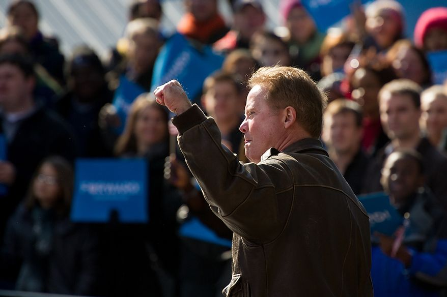 Sen. Jim Webb (D-Va.) arrives to warm up the crowd before Vice President Joe Biden and his wife, Dr. Jill Biden, join Virginia Democratic candidate for Senate Tim Kaine, at a campaign rally at the Heritage Farm Museum at Claude Moore Park, Sterling, Va., Monday, November 5, 2012. (Andrew Harnik/The Washington Times)
