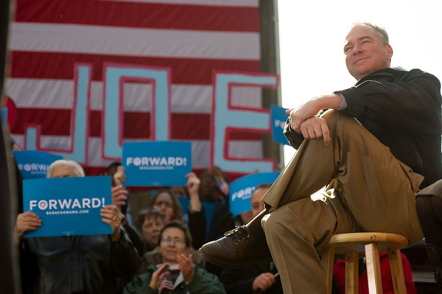 Virginia Democratic candidate for Senate Tim Kaine, right, sits on stage and listens to Vice President Joe Biden speak at a campaign rally at the Heritage Farm Museum at Claude Moore Park, Sterling, Va., Monday, November 5, 2012. (Andrew Harnik/The Washington Times)