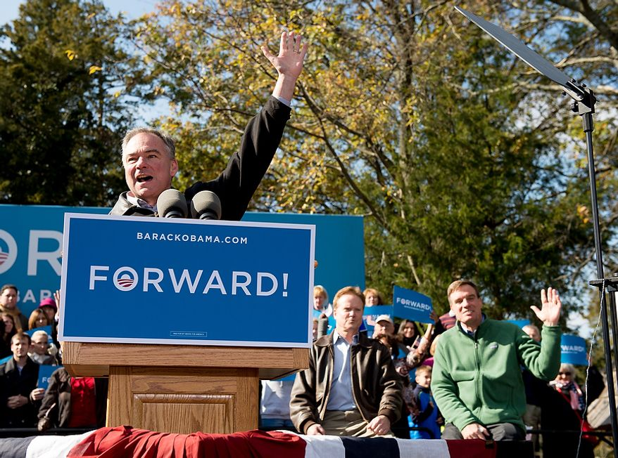 Democratic candidate for Senate Tim Kaine, left, is welcomed to the stage by Sen. Jim Webb (D-Va.), second from right, and Sen. Mark Warner (D-Va.), right, at a campaign rally at the Heritage Farm Museum at Claude Moore Park, Sterling, Va., Monday, November 5, 2012. (Andrew Harnik/The Washington Times)