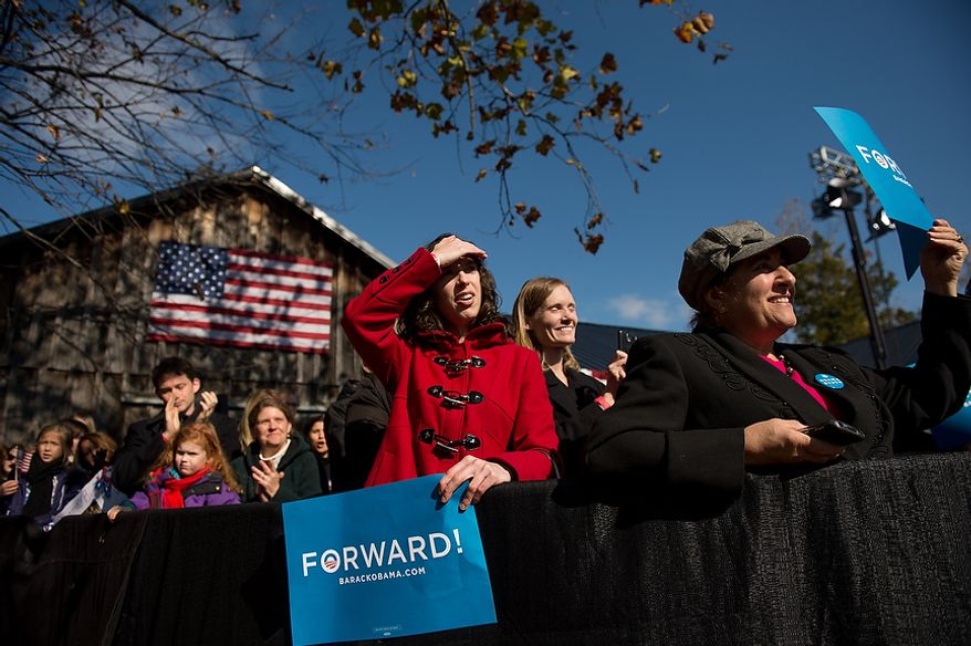 Supporter cheer for Democratic candidate for Senate Tim Kaine as he speaks at a campaign rally for Vice President Joe Biden at the Heritage Farm Museum at Claude Moore Park, Sterling, Va., Monday, November 5, 2012. (Andrew Harnik/The Washington Times)