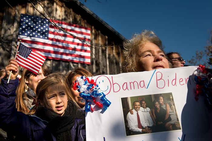 Supporters Laylah Bradley, 7, of Alexandria, Va., left, and Cei Richardson [cq], right, of Falls Church, Va., right, listens as Vice President Joe Biden speaks at a campaign rally at the Heritage Farm Museum at Claude Moore Park, Sterling, Va., Monday, November 5, 2012. Biden was joined on stage by his wife, Dr. Jill Biden, Virginia Democratic candidate for Senate Tim Kaine, Sen. Jim Webb (D-Va.), and Sen. Mark Warner (D-Va.). (Andrew Harnik/The Washington Times)