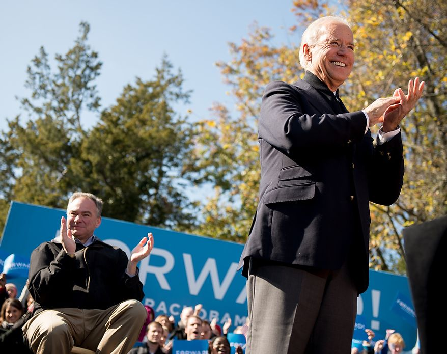 Vice President Joe Biden, right, joins Virginia Democratic candidate for Senate Tim Kaine, left, at a campaign rally at the Heritage Farm Museum at Claude Moore Park, Sterling, Va., Monday, November 5, 2012. (Andrew Harnik/The Washington Times)