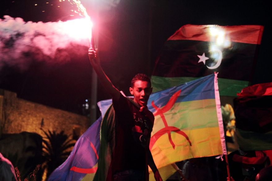 Libyans celebrate one year on since the country was declared liberated from former dictator Moammar Gadhafi, at Martyrs Square in Tripoli, Libya , on Tuesday, Oct. 23, 2012. (AP Photo/Gaia Anderson)