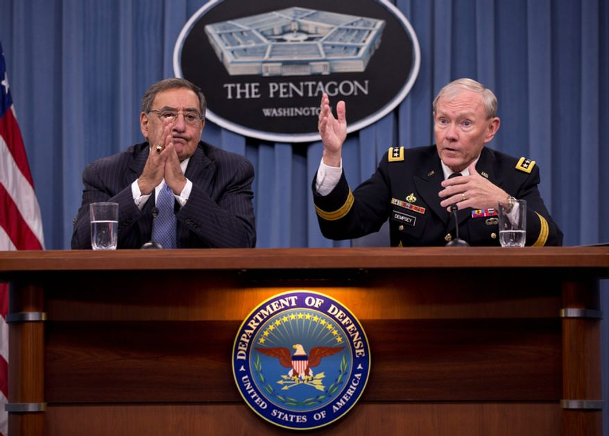 Gen. Martin Dempsey, chairman of the Joint Chiefs of Staff, accompanied by Defense Secretary Leon E. Panetta, gestures during their joint news conference at the Pentagon on Thursday, Oct. 25, 2012. During the news conference, Mr. Panetta said the U.S. military did not intervene during the attack on the U.S. Consulate in Libya last month because it was over before the U.S. has sufficient information on which way to respond. (AP Photo/Carolyn Kaster)