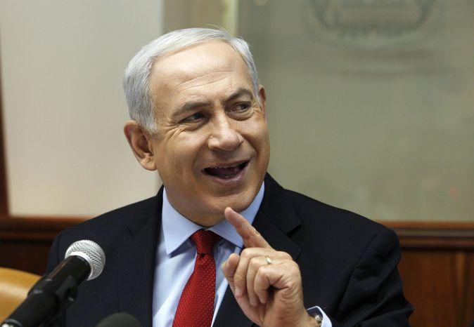 **FILE** Israeli Prime Minister Benjamin Netanyahu attends a weekly cabinet meeting in Jerusalem on Nov. 4, 2012. (Associated Press)