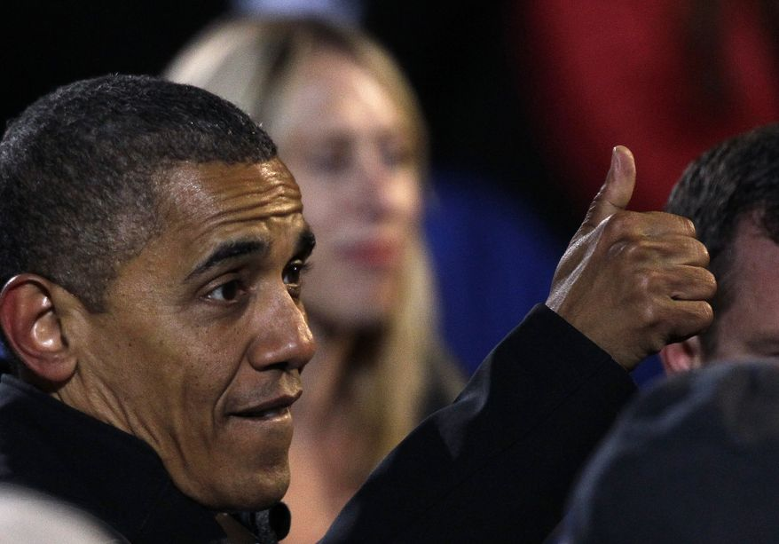 President Obama gives a thumbs up to a supporter at a campaign rally at the Community College of Aurora in Aurora, Colo. on Nov. 4, 2012. (Associated Press)