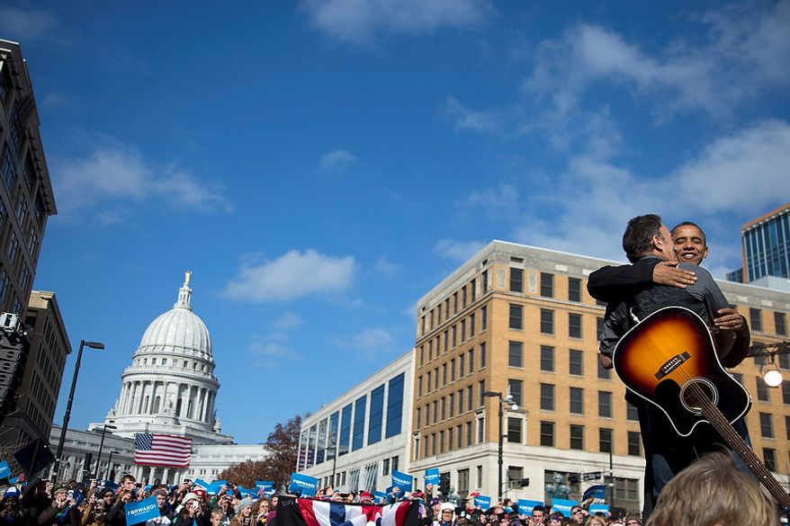 President Obama is greeted onstage by singer Bruce Springsteen as he arrives to speak at a campaign event on Monday, Nov. 5, 2012, in downtown Madison, Wis. (AP Photo/Carolyn Kaster)