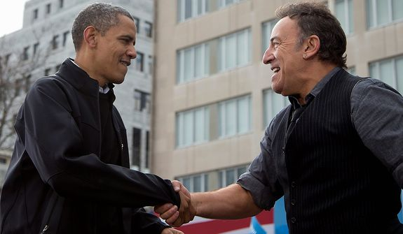 President Obama shakes hands with singer Bruce Springsteen at a campaign event on Monday, Nov. 5, 2012, in downtown Madison, Wis. (AP Photo/Carolyn Kaster)