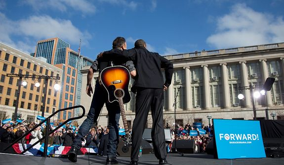 President Obama stands with singer Bruce Springsteen as he arrives to speak at a campaign event on Monday, Nov. 5, 2012, in Madison, Wis. (AP Photo/Carolyn Kaster)