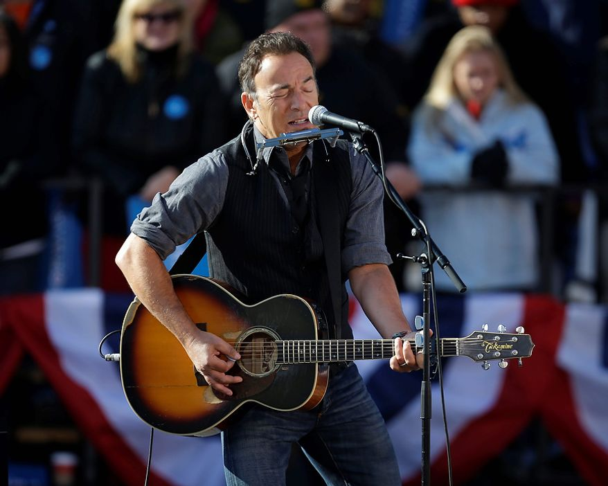 Singer Bruce Springsteen performs before the start of a campaign event for President Obama near the Capitol in Madison, Wis., on Monday, Nov. 5, 2012. (AP Photo/Pablo Martinez Monsivais)