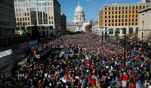 President Obama speaks to supporters during a campaign event near the Capitol in Madison, Wis., on Monday, Nov. 5, 2012. (AP Photo/Pablo Martinez Monsivais)