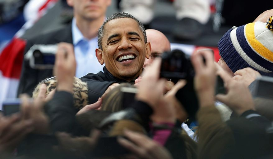 President Obama greets supporters during a campaign event near the Capitol in Madison, Wis., on Monday, Nov. 5, 2012. (AP Photo/Pablo Martinez Monsivais)