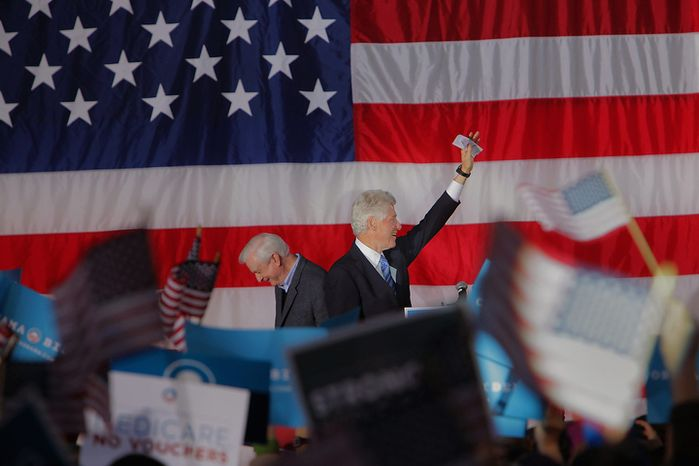 Former President Bill Clinton (right) arrives Nov. 4, 2012, at a rally for President Obama at Pullen Park in Raleigh, N.C., after being introduced by former North Carolina Gov. Jim Hunt (left). The former president has been traveling to several battleground states over the past week to try to stem any Republican tide for Mitt Romney and preserve Obama leads. (Associated Press)