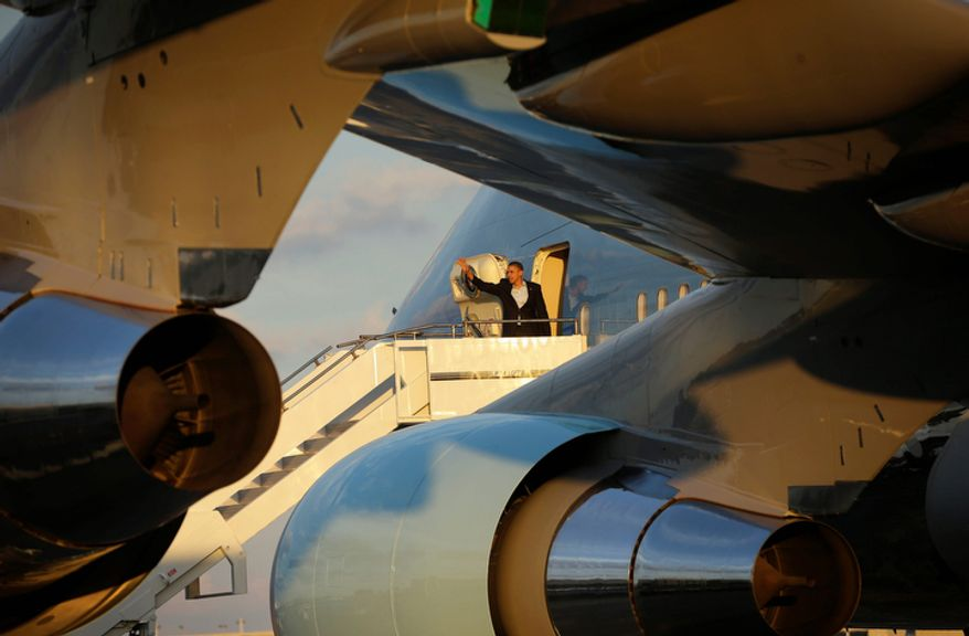 President Obama waves Nov. 4, 2012, as he boards Air Force One for his departure at Fort Lauderdale-Hollywood International Airport in Fort Lauderdale, Fla. (Associated Press)