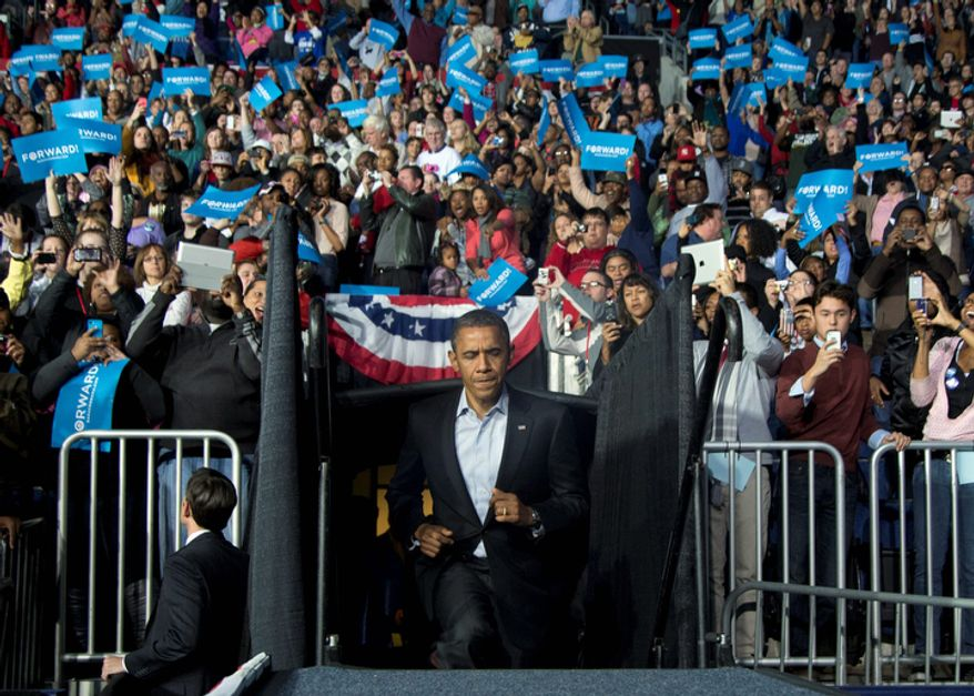 President Barack Obama walks up and onto the stage as the crowd cheers at a campaign event at Nationwide Arena, Monday, Nov. 5, 2012, in Columbus, Ohio.  (AP Photo/Carolyn Kaster)