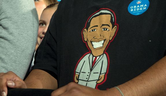 A little girl peeks from behind a man with an image of a smiling President Barack Obama as President Obama speaks at a campaign event at Nationwide Arena, Monday, Nov. 5, 2012, in Columbus, Ohio.  (AP Photo/Carolyn Kaster)