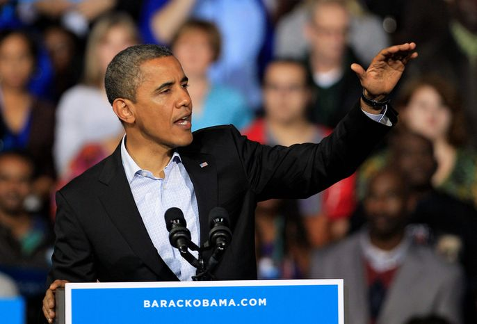 President Barack Obama speaks at a campaign event at Nationwide Arena Monday, Nov. 5, 2012, in Columbus, Ohio. (AP Photo/Tony Dejak)