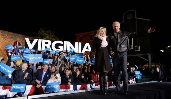 Vice President Joe Biden accompanied by his wife Jill Biden enters a campaign rally at the American Civil War Center at the Historic Tredegar Ironworks Monday, Nov. 5, 2012, in Richmond, Va. (AP Photo/Matt Rourke)