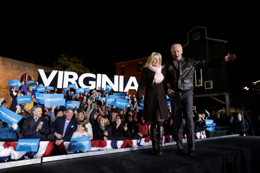 Vice President Joe Biden accompanied by his wife Jill Biden enters a campaign rally at the American Civil War Center at the Historic Tredegar Ironworks Monday, Nov. 5, 2012, in Richmond, Va. (AP Photo/Matt Rourke)