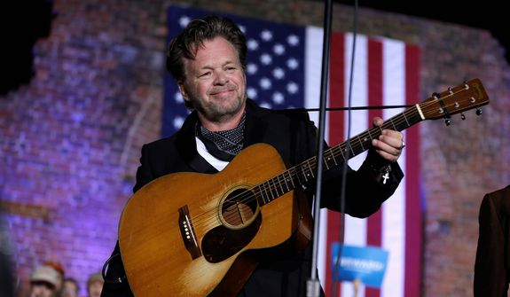 John Mellencamp performs before Vice President Joe Biden speaks during a campaign rally at the American Civil War Center at the Historic Tredegar Ironworks Monday, Nov. 5, 2012, in Richmond, Va. (AP Photo/Matt Rourke)