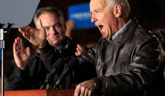 Vice president Joe Biden gestures during campaign rally at The American Civil War Center at Historic Tredegar Ironworks, as Democratic Senate candidate Timothy Kaine, left, listens in Richmond, Va., Monday, Nov. 5, 2012.  (AP Photo/Steve Helber)