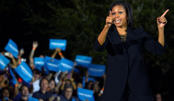 First lady Michelle Obama addresses the crowd during a campaign stop for her husband, President Barack Obama, on election eve in Orlando, Fla., Monday, Nov. 5, 2012.(AP Photo/Phelan M. Ebenhack)