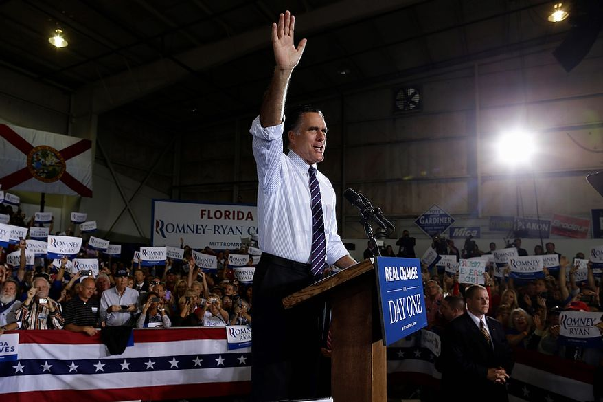 Republican presidential candidate Mitt Romney waves during a campaign rally at Orlando Sanford International Airport in Sanford, Fla., on Monday, Nov. 5, 2012. (AP Photo/Charles Dharapak)