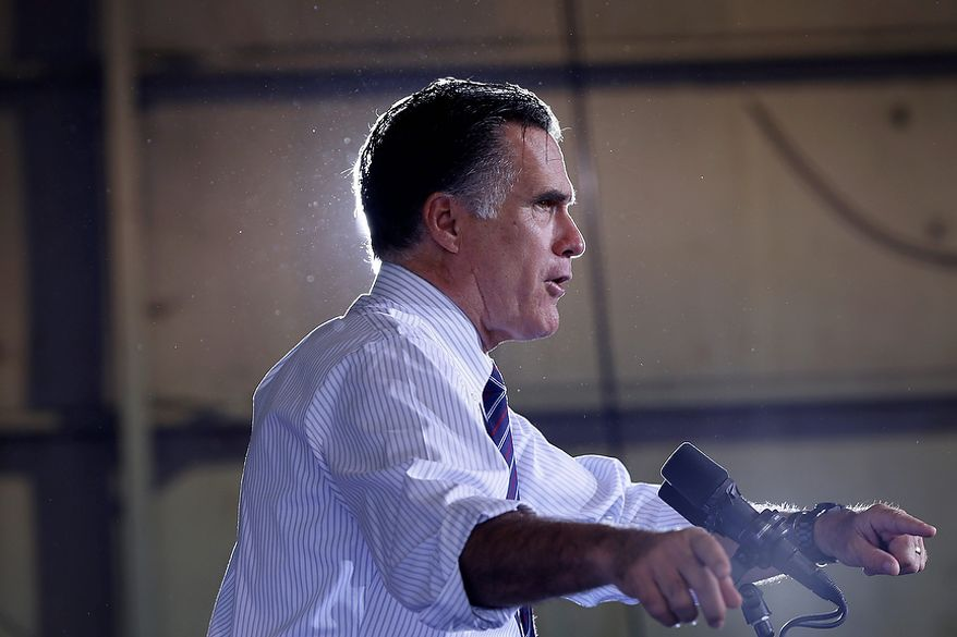 Republican presidential candidate Mitt Romney speaks at a campaign rally at Orlando Sanford International Airport in Sanford, Fla., on Monday, Nov. 5, 2012. (AP Photo/Charles Dharapak)