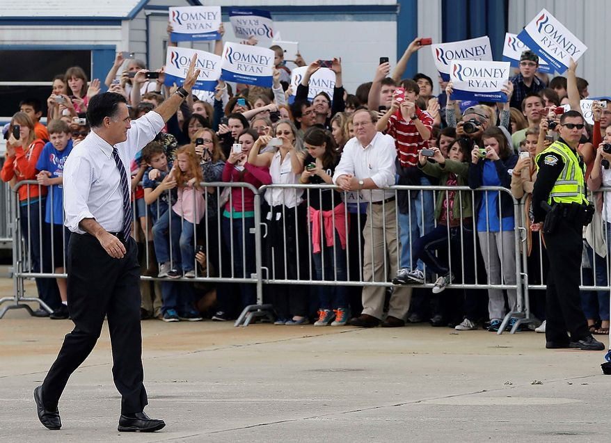 Republican presidential candidate Mitt Romney waves to supporters as he walks back to his plane after a campaign rally at Orlando Sanford International Airport in Sanford, Fla., on Monday, Nov. 5, 2012. (AP Photo/Charles Dharapak)