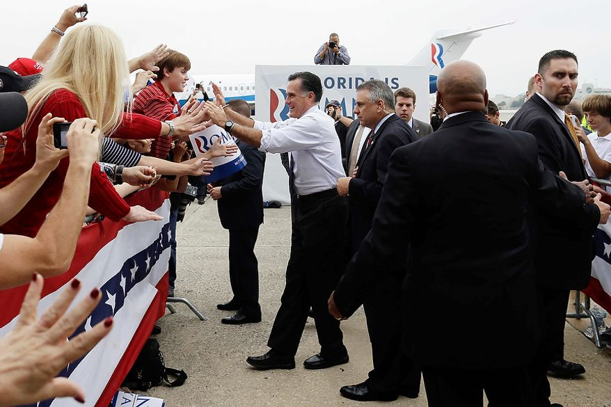 Republican presidential candidate Mitt Romney greets supporters at a campaign rally at Orlando Sanford International Airport in Sanford, Fla., on Monday, Nov. 5, 2012. (AP Photo/Charles Dharapak)