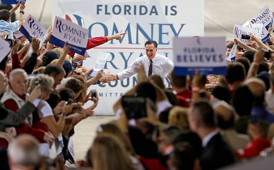 Republican presidential candidate Mitt Romney greets supporters as he arrives to speak at a campaign event at Orlando Sanford International Airport on Monday, Nov. 5, 2012, in Sanford, Fla. (AP Photo/David Goldman)