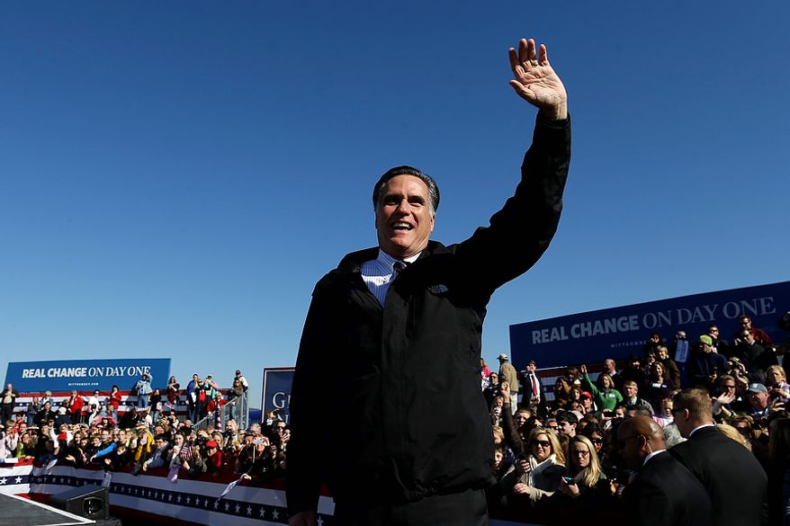 Republican presidential candidate, former Massachusetts Gov. Mitt Romney waves to supporters at a Virginia campaign rally at Lynchburg Regional Airport, in Lynchburg, Va., Monday, Nov. 5, 2012. (AP Photo/Charles Dharapak)