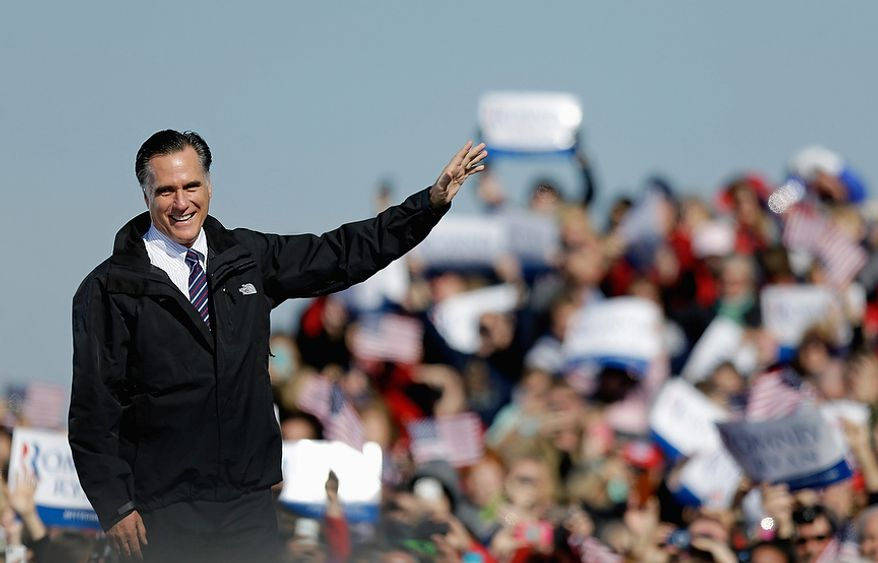 Republican presidential candidate, former Massachusetts Gov. Mitt Romney waves as he speaks during a campaign event at the Lynchburg Regional Airport, Monday, Nov. 5, 2012, in Lynchburg, Va. (AP Photo/David Goldman)