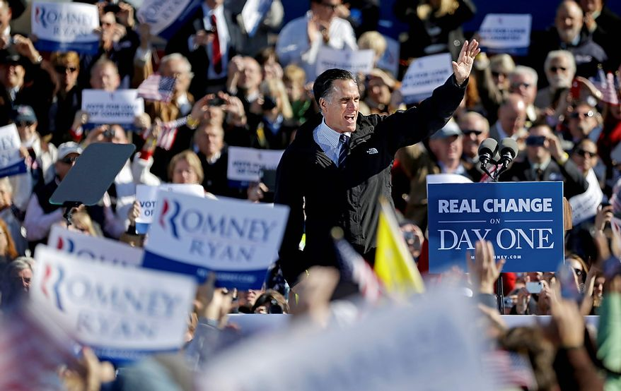 Republican presidential candidate, former Massachusetts Gov. Mitt Romney waves to supporters after finishing his speech at a campaign event at the Lynchburg Regional Airport, Monday, Nov. 5, 2012, in Lynchburg, Va. (AP Photo/David Goldman)