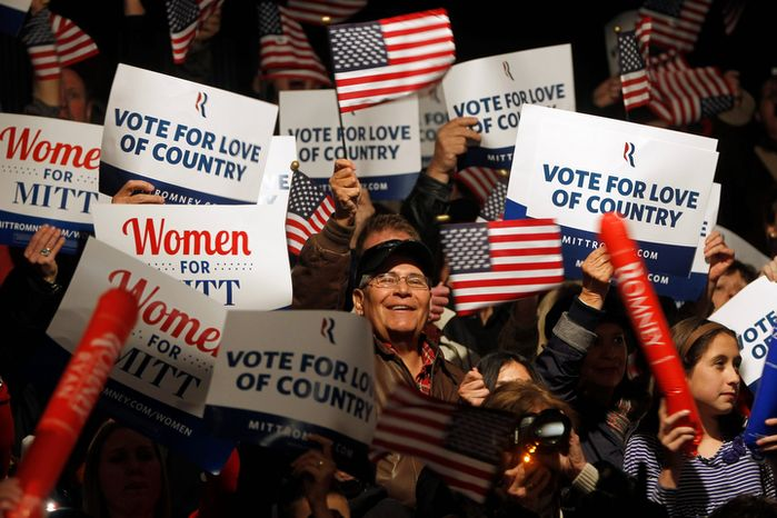 Supporters cheer as Rep. Paul Ryan, the Republican vice presidential candidate, speaks during a campaign event at the Douglas County Fairgrounds on Sunday, Nov. 4, 2012, in Castle Rock, Colo. (AP Photo/Mary Altaffer)