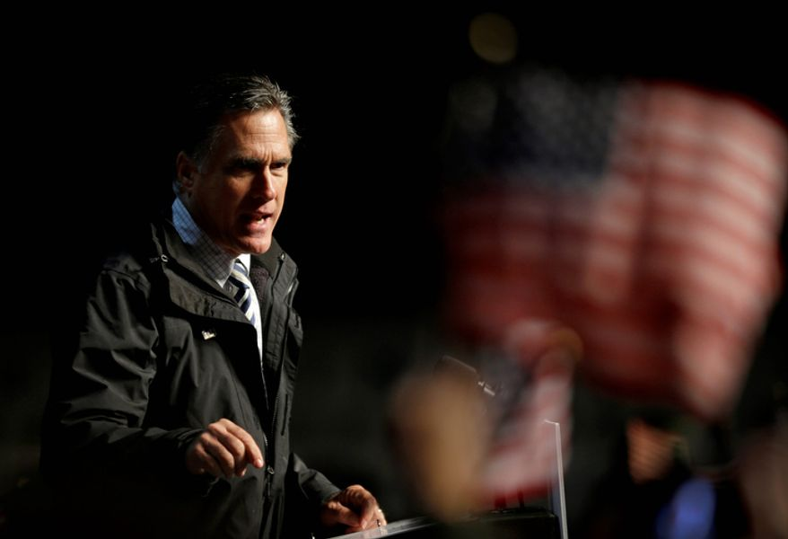 Republican presidential candidate Mitt Romney speaks during a campaign event at the Newport News/Williamsburg International Airport on Sunday, Nov. 4, 2012, in Newport News, Va. (AP Photo/David Goldman)