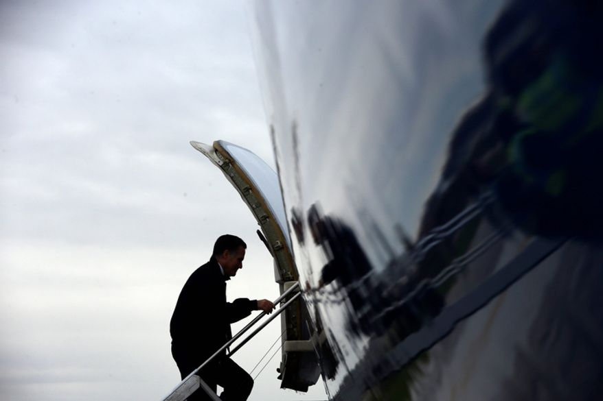 Republican presidential candidate Mitt Romney boards his plane after campaigning at the International Exposition Center in Cleveland on Sunday, Nov. 4, 2012. (AP Photo/Charles Dharapak)