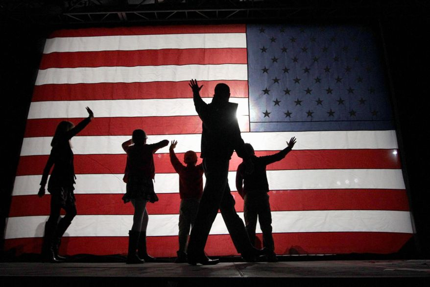Republican vice presidential candidate, Rep. Paul Ryan, R-Wis., waves as he comes off the stage with his wife Janna, left, daughter Liza, second from left, and sons Sam and Charlie, right, during a campaign event, Monday, Nov. 5, 2012 in Reno, Nev.  (AP Photo/Mary Altaffer)