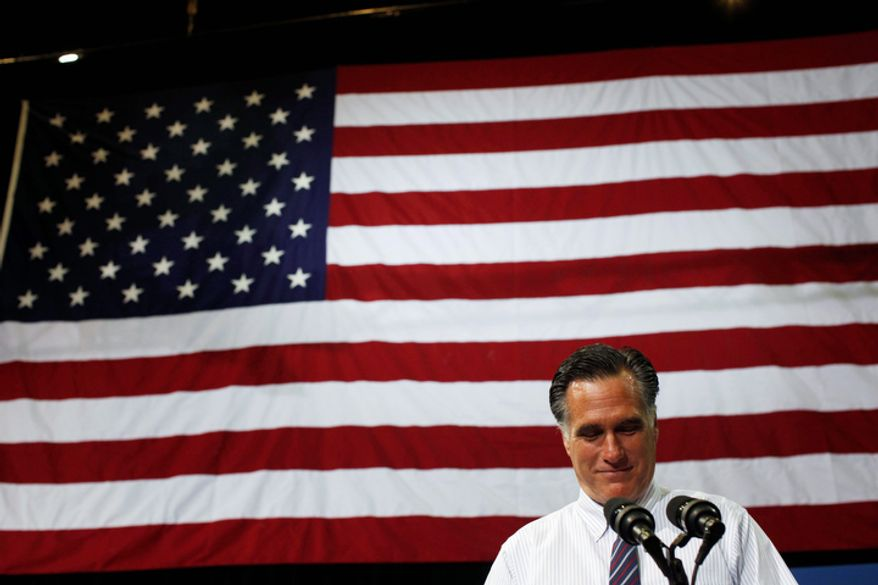 Republican presidential candidate and former Massachusetts Gov. Mitt Romney pauses while speaking at a campaign rally at The Patriot Center at George Mason University in Fairfax, Va., Monday, Nov. 5, 2012. (AP Photo/Charles Dharapak)