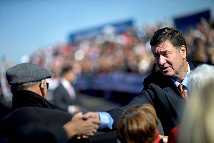 Virginia Republican Senate candidate George Allen greets crowd members before Republican presidential candidate, former Massachusetts Gov. Mitt Romney appeared at a campaign event at the Lynchburg Regional Airport, Monday, Nov. 5, 2012, in Lynchburg, Va. (AP Photo/David Goldman)